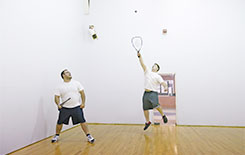 Guys playing racquetball