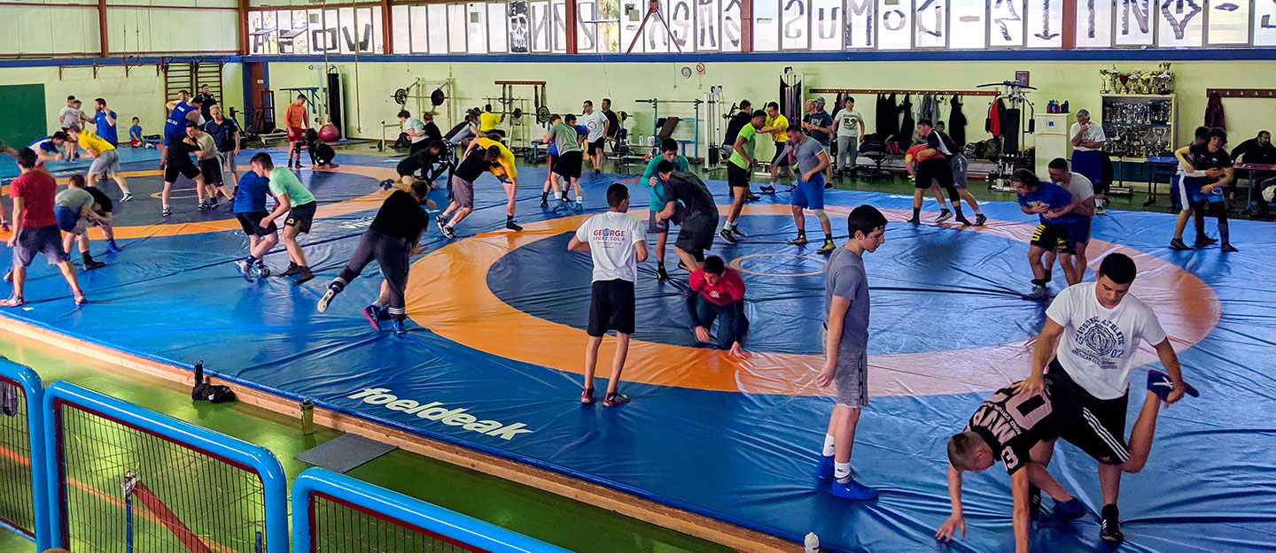 The UNK wrestling team trains with Atlas Kallitheas, the top wrestling club in Athens, during last month's trip to Greece.